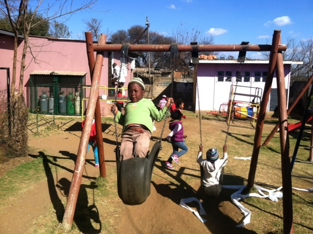 Children play near the Kliptown Youth Program in the Kliptown community in Soweto, South Africa.  Photo by Isaac Riddle