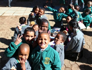 The mild climate allows students at Emmarentia Primary School to eat lunch outside most days.  Photo by Isaac Riddle