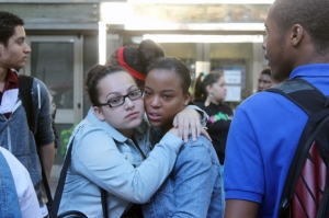 Two student comfort each other as most protestors decide to return to class.  Photo by Isaac Riddle