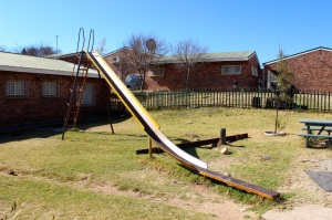 The playground at Skeen Primary School consists of an old slide, a broken teeter totter and a unusable swing set. Photo by Isaac Riddle